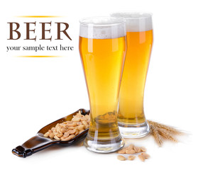 Glasses of beer with snack isolated on white