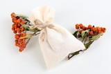 Textile sachet pouch with dried berries isolated on white