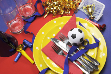 Soccer party table in red, yellow and blue team colors