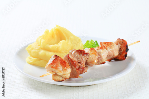 Pork souvlaki with mashed potato