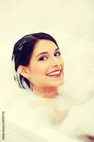 Young woman taking bath