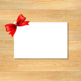 Red Bow And Blank Gift Tag With Wooden Wallpaper