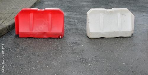 two plastic road barriers