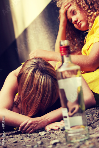 Drunk teens with vodka bottle