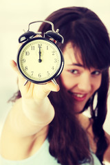 A teen woman with alarm clock