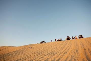 Tourists in Sahara desert