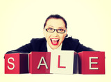 Businesswoman with sale sign