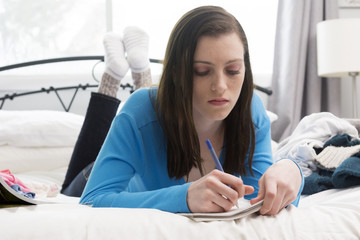 Teenage Girl Writing in Journal