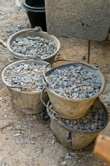 raw material for construction, stone and pail