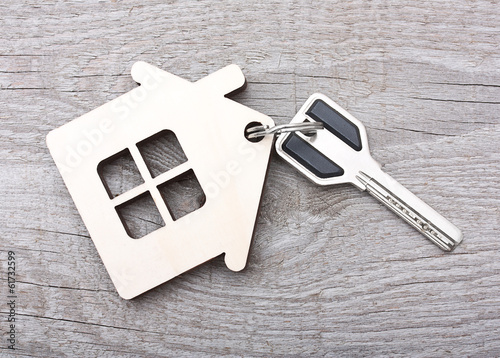 Key with house on wooden desk