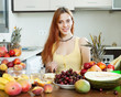 Positive  woman making  fruit salad