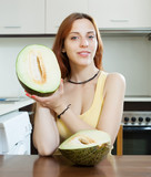 young housewife holding ripe melon
