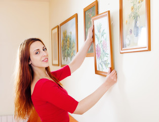 Long-haired woman in red hanging  pictures