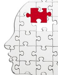 tête puzzle avec pièce enlevée