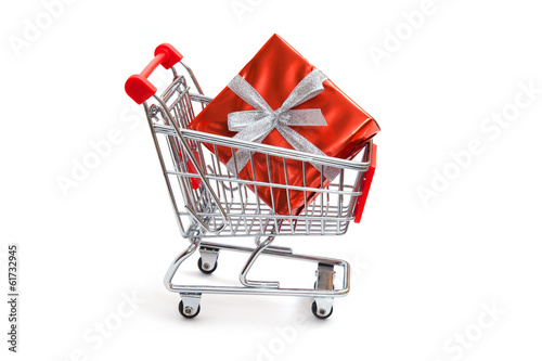 Present in sweetie paper lie in shopping cart