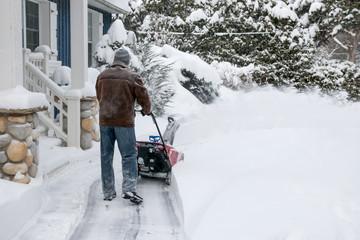 Man using snowblower in deep snow