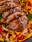 Fried dack meat with egg noodles