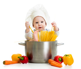 cook baby sitting inside pan with pasta and healthy food
