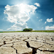 drought earth and sun in cloudy sky - 61735313
