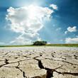 Leinwanddruck Bild - drought earth and sun in cloudy sky