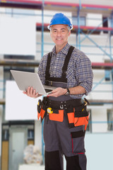 Repairman Holding Laptop