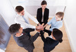 Group Of Businesspeople Stacking Their Hands