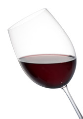 Tilted elegant glass of red wine