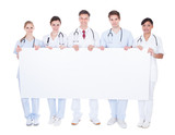 Group Of Doctors With Blank Billboard