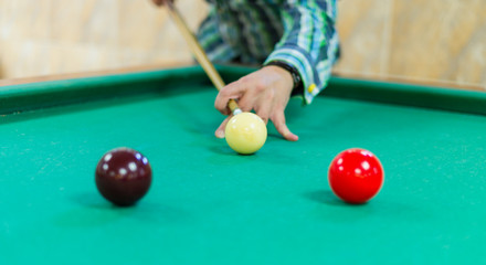 Young man playing snooker. Billiard