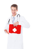Doctor Holding First Aid Box