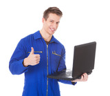 Male Technician Using Laptop