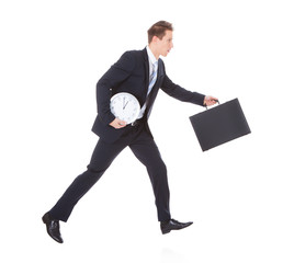 Businessman Running Holding Briefcase And Clock