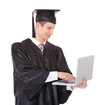 Graduate Man Using Laptop