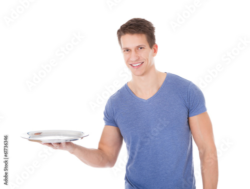 Happy Young Man Holding Empty Plate