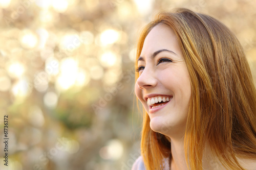 Facial portrait of a funny woman face laughing
