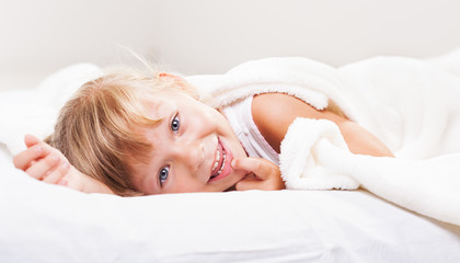Cute little girl in the bed.