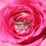Engagement and wedding rings in pink rose. Closeup