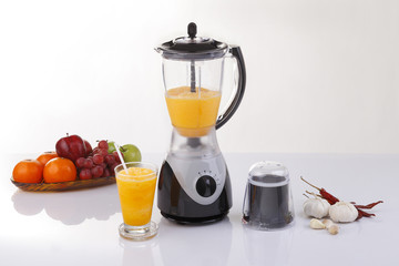 Electric blender with fruits and orange juice