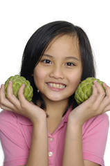 Close up girl with custard apple