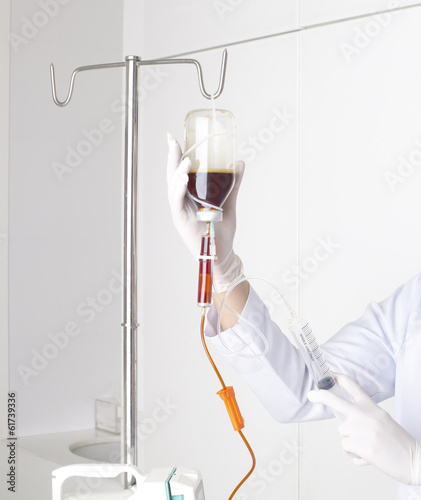 nurse doing infusion with syringe