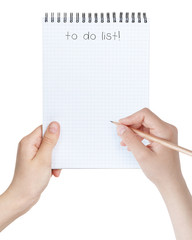 female teen girls holding notepad with to-do list