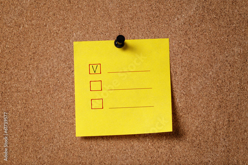 sticker note on cork board with checkboxes