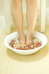Woman in footbath of Rose Red and lemon
