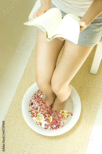 Woman reading a book in footbath of Rose Red and lemon