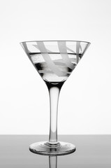 Glass goblet with water.