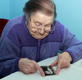 Old grandmother looking at the pictures of their youth