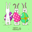 Three bunny rabbits holding Easter eggs