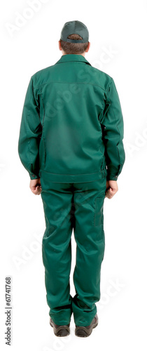 Worker in green workwear. Back view.
