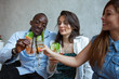 people of various ethnic groups are celebrating with a drink at