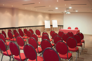red chairs in conference room